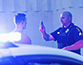 Police officer conducts a traffic stop to give sobriety test to young man.