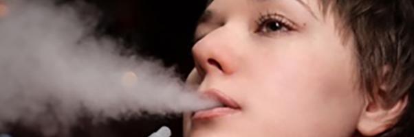 A teenage girl smoking