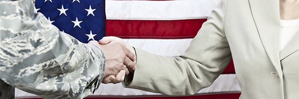 Soldier in uniform shaking hands with woman attorney
