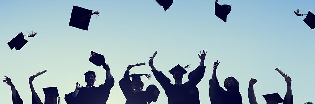 Grads throwing morter board hats