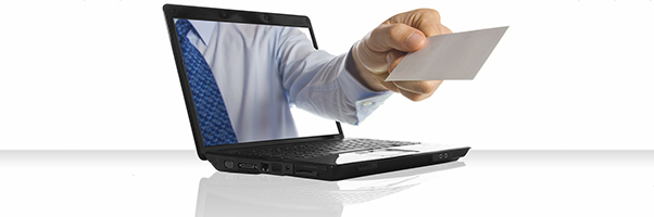 A hand sticking through a laptop giving a business card