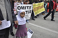Muslim girl leading a protest march in Seattle
