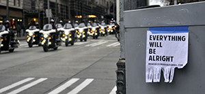 Police on motorcycles escorting protest march in Seattle.