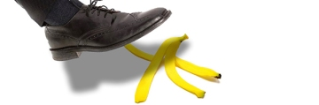 A wingtip shoe about to slip on a banana peel.
