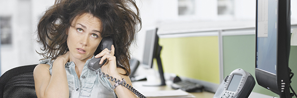 Frazzled woman attorney on telephone