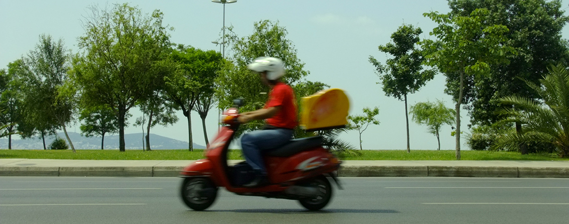 Courier riding a scooter
