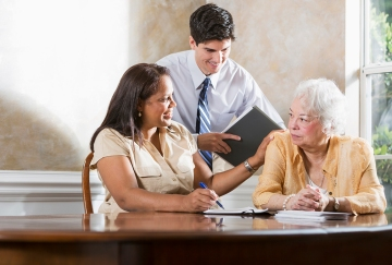 Pro bono attorneys advising a senior woman